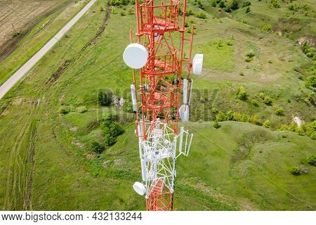 Technology On The Top Of The Telecommunication Gsm 5g Tower. Cellular Phone Antennas Countryside. Te
