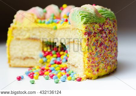 Madeira Sponge Coated With Yellow Colour Frosting, Layered With Plum And Raspberry Jam, Filled And T