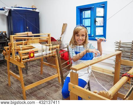 Girl, Loom And Threads. Antique Equipment For The Production Of Carpets, Clothing And Woven Househol