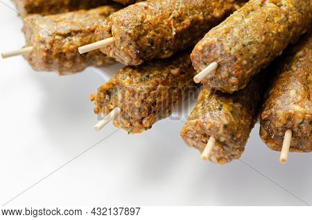 Minced And Shaped Lamb Kebabs With Chilli And Coriander Prepared For Grill