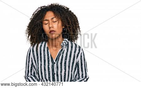 Young african american girl wearing casual clothes with hand on stomach because indigestion, painful illness feeling unwell. ache concept.