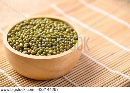 Mung Bean Seeds In A Wooden Bowl, Food Ingredients In Asian Cuisine And Produce Mung Bean Sprout