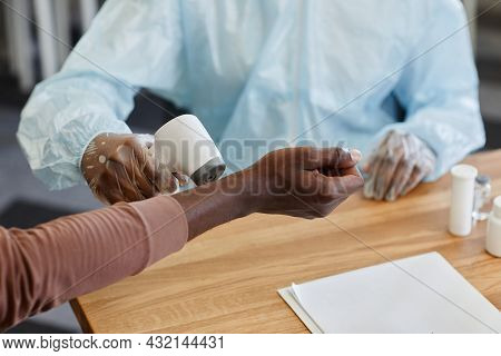 Close-up Iamge Of Doctor Checking Temperature Of Patient By Scanning His Wrist With Infrared Thermom