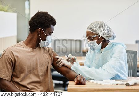 Young African-american Man Getting Second Shot Of Covid-19 Vaccine In Hospital