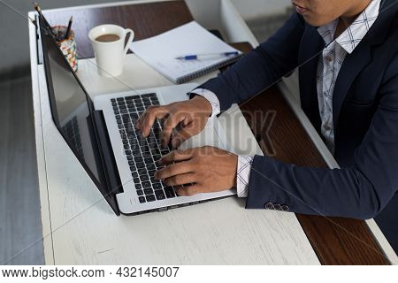 Side View Of Unrecognizable Businessman Typing On Laptop. Closeup Hands On The Computer Keyboard Typ
