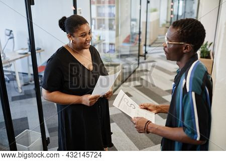 Positive Businesswoman With Report In Hand Asking Couple Questions Her Colleague She Met In Office C