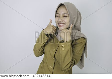 Oke Sign With Smile Government Worker Women Standing Confidance. Pns Wearing Khaki Uniform.