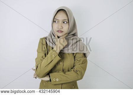 Confused Government Worker Women Have Thinking Gesture. Pns Wearing Khaki Uniform.