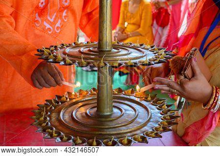 Goddess Durga Is Being Worshipped By Hindu Priest. Holy Panchapradip Is Being Lit During Sondhipujo