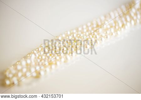Necklace Of The Pearl On A White Background And Copy Space. Close Up.
