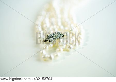 The Clasp Of Pearl Necklace On A White Background And Copy Space. Close Up.