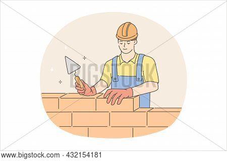 Builder Man During Work Concept. Young Man Worker Builder In Helmet And Uniform Standing Building Wa