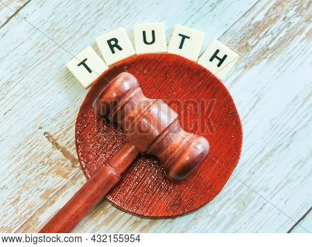Phrase Truth Lettering Created Using Square Letter Tiles With Gavel Isolated On Dark Background.