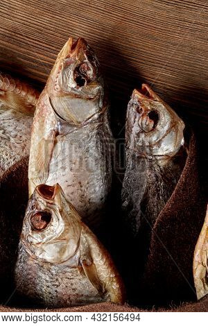 Ssalted Air-dried Fish Wrapped In Genuine Leather On Wooden Background