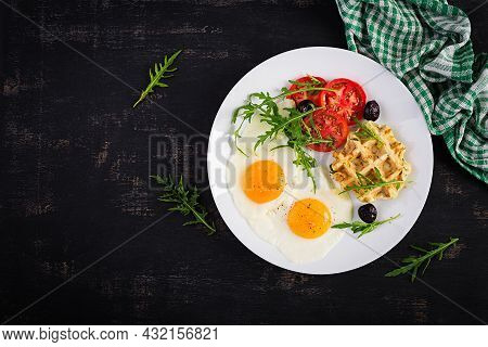 Breakfast With Zucchini Waffles, Fried Eggs, Tomato, Black Olives And Arugula On White Background. A