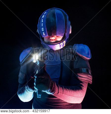 Cyberpunk Future Concept. Police Officer Cop, Halfman Aims Around In Dar. Bionic Cyborg Robot Is In