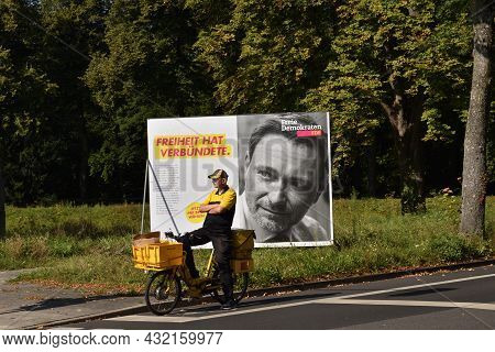 Duesseldorf, Germany - September 02, 2021: Advertising posters and banners for German federal election. Poster. Postman on FDP poster background