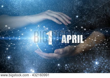 April 1st . Day 1 Of Month, Calendar Date. Human Holding In Hands Earth Globe Planet With Calendar D