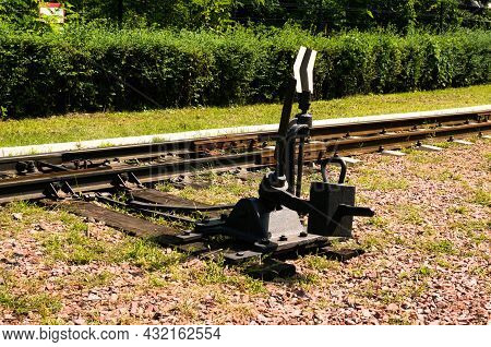 Detailed View Of Manual Railroad Switch. Black Railroad Direction Switch. Kyiv Children's Railway In