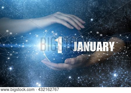January 1st . Day 1 Of Month, Calendar Date. Human Holding In Hands Earth Globe Planet With Calendar