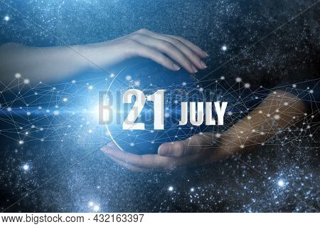 July 21st . Day 21 Of Month, Calendar Date. Human Holding In Hands Earth Globe Planet With Calendar