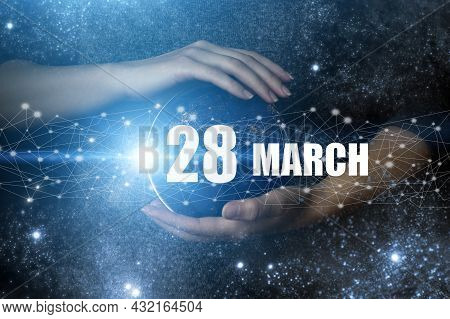 March 28th. Day 28 Of Month, Calendar Date. Human Holding In Hands Earth Globe Planet With Calendar