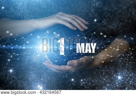 May 1st . Day 1 Of Month, Calendar Date. Human Holding In Hands Earth Globe Planet With Calendar Day