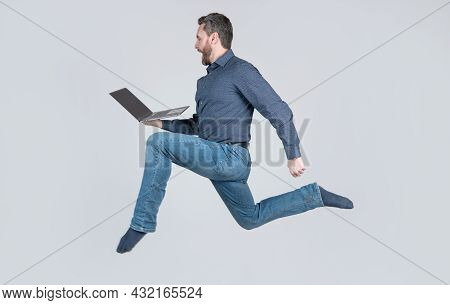 Surprised Energetic Man Running While Working Online On Laptop Hurry Up For Shopping, Shopping.