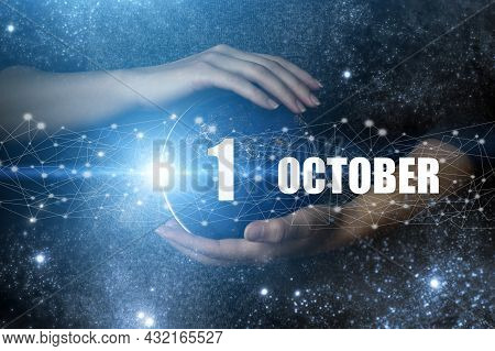 October 1st . Day 1 Of Month, Calendar Date. Human Holding In Hands Earth Globe Planet With Calendar