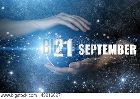 September 21st . Day 21 Of Month, Calendar Date. Human Holding In Hands Earth Globe Planet With Cale