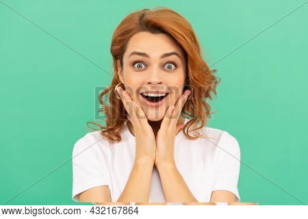 Surprised Redhead Girl With Curly Hair And Healthy Skin On Blue Background, Surprise