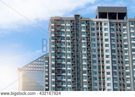Apartment Building. Exterior Of Skyscraper Building. Transparent Glass Windows Of Apartment. Back Vi