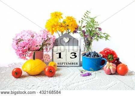 Calendar For September 13 : The Name Of The Month In English, Cubes With The Number 13, Ripe Vegetab
