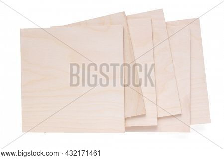 Plywood boards isolated on white background. Stack of plywood pieces on white