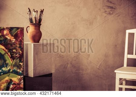 Paint brush and art painting canvas as abstract background texture. Paintbrush for painting for artistic paint still life. Abstract art concept