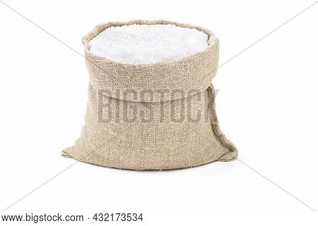 Salt In A Sack Isolated On A White Background. Salt . Salt In A Burlap Sack. Salt In A Jute Bag.