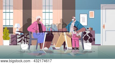 Happy African American Grandparents With Granddaughter Using Laptop Social Media Network Online Comm