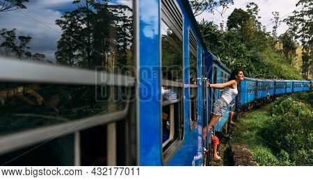 A Tourist Travels By Train To Beautiful Places, A Panorama. A Beautiful Woman Travels By Train Aroun