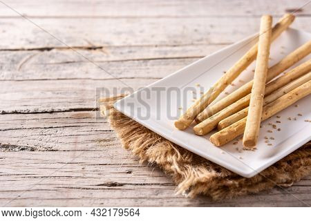 Breadstick Grissini Snack On Rustic Wooden Table. Copy Space