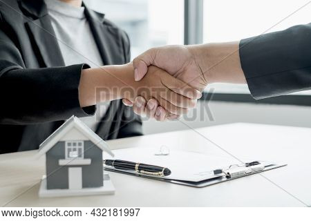 Business And Brokers Real Estate Agents Shake Hand After Completing Negotiations To Buy Houses Insur