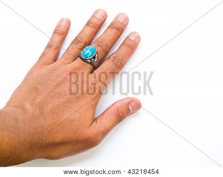 A Guy Hand With Turquoise  Ring On His Finger Isolated On White Background