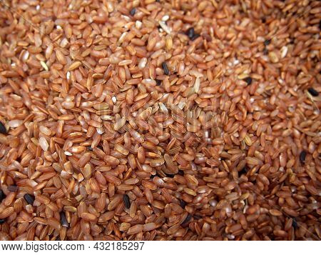 Red Rice. Red Rice Is A Variety Of Rice That Is Colored Red By Its Anthocyanin Content. It Is Usuall