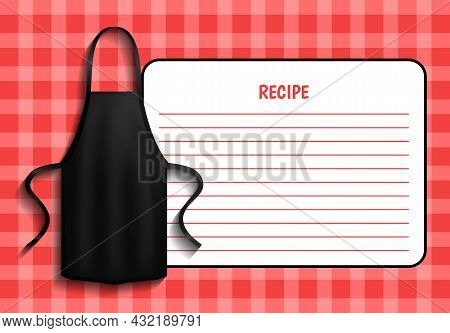 Black Apron Next To Piece Of Paper With Recipe. Clothes For Work In Kitchen, Protective Element Of C