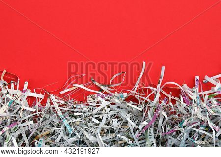 The White Shredded Paper On Red Background.