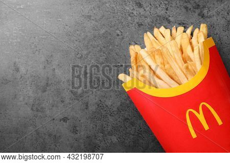 Mykolaiv, Ukraine - August 12, 2021: Big Portion Of Mcdonald's French Fries On Grey Table, Top View.