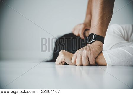 Close Up Of Man Hands Holding A Woman Hands For Rape