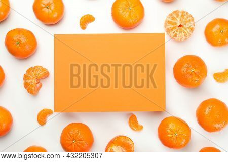 Mandarins And Orange Space For Text On White Background