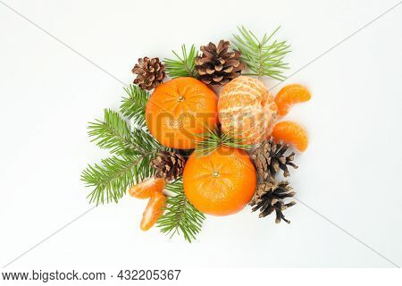 Mandarins, Cones And Spruce Branches On White Background