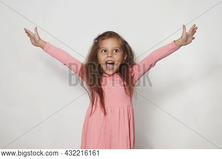 Portrait Of Cute Happy Child Girl Against White Background