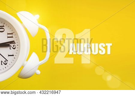 August 21st . Day 21 Of Month, Calendar Date. White Alarm Clock On Yellow Background With Calendar D